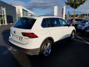 Photo n°2 de l'annonce de VOLKSWAGEN Tiguan 2.0 TDI 150ch BlueMotion Technology Confortline Business occasion de couleur PURE WHITE à vendre à Onet-le-Château